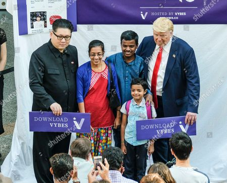 Hong Kong-based Kim Jung-Un impersonator Howard X, and Trump impersonator  Dennis Alan seen having photos taken with locals as the real US president Donald Trump and the North Korean leader Kim Jung Un touched down in Singapore for their historic summit.