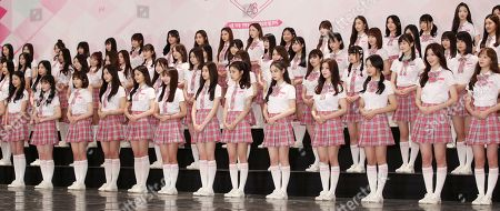 Girl group trainees pose during an event at the Imperial Palace Hotel in southern Seoul, South Korea, 11 June 2018, to promote Mnet's 'Produce 48,' a survival reality show to produce a girl group by public voting out of 96 South Korean and Japanese trainees.