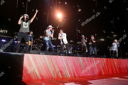 Stock Photo of Kevin Richardson, Brian Kelley, Howie D., Brian Littrell, Nick Carter, AJ McClean. From left, artists Kevin Richardson of the Backstreet Boys, Brian Kelley of Florida Georgia Line, and Howie D., Brian Littrell, Nick Carter and AJ McClean of the Backstreet Boys perform at the 2018 CMA Music Festival at Nissan Stadium on in Nashville, Tenn