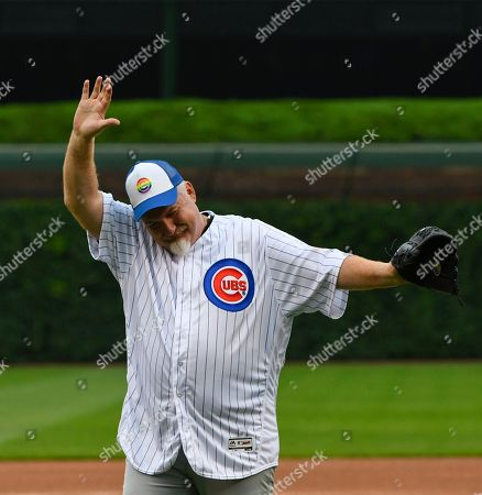 Stock Image of Chef Art Smith after throwing out a ceremonial first pitch before the baseball game between the Pittsburgh Pirates and the Chicago Cubs, in Chicago