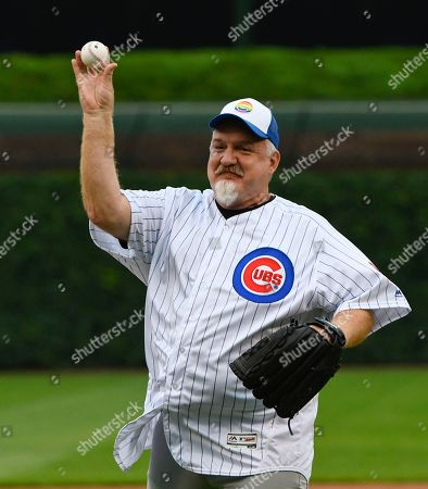 Stock Picture of Chef Art Smith throws out a ceremonial first pitch before the baseball game between the Pittsburgh Pirates and the Chicago Cubs, in Chicago