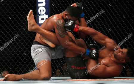 Alistair Overeem, right, lands a punch on Curtis Blaydes during their heavyweight UFC 225 Mixed Martial Arts bout, in Chicago