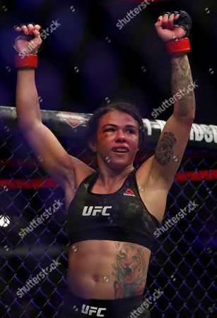 Claudia Gadelha reacts after her fight against Carla Esparza during their women's strawweight UFC 225 Mixed Martial Arts bout, in Chicago