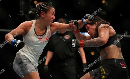 Claudia Gadelha, right, and Carla Esparza fight during their women's strawweight UFC 225 Mixed Martial Arts bout, in Chicago