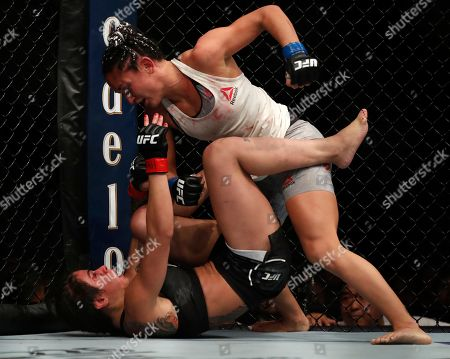 Claudia Gadelha, bottom, and Carla Esparza fight during their women's strawweight UFC 225 Mixed Martial Arts bout, in Chicago
