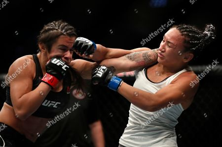 Claudia Gadelha,left, and Carla Esparza fight during their women's strawweight UFC 225 Mixed Martial Arts bout, in Chicago