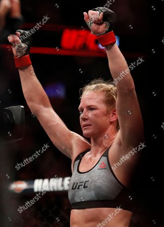Holly Holm celebrates her win against Megan Anderson during their Women's featherweight UFC 225 Mixed Martial Arts bout, in Chicago