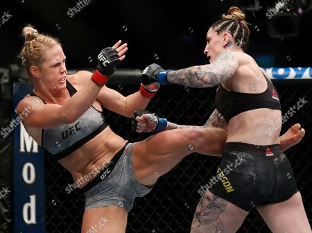 Holly Holm, left, and Megan Anderson fight during their Women's featherweight UFC 225 Mixed Martial Arts bout, in Chicago