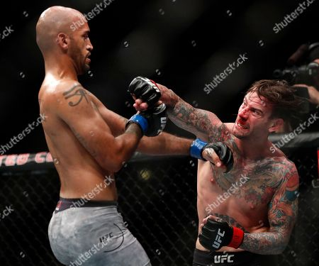 Stock Photo of CM Punk, right, and Mike Jackson fight during their welterweight UFC 225 Mixed Martial Arts bout, in Chicago