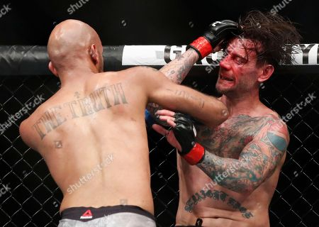 CM Punk, right, and Mike Jackson fight during their welterweight UFC 225 Mixed Martial Arts bout, in Chicago