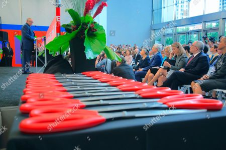 3 World Trade - Ribbon Cutting. Sixteen pairs of sissies are laid out as Silverstein Properties Chairman Larry Silverstein, far left, address a gathering during a ribbon cutting ceremony at the opening for 3 World Trade Center, in New York