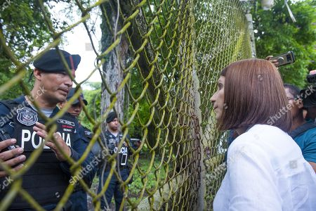 Stock Picture of Marta Linares (R), wife of former Panamanian president Ricardo Martinelli, talks to an officer at El Renacer prison, in Panama City, Panama, 11 June 2018. Relatives and friends of Martinelli, as well as a handful of workers from his supermarkets chain, rallied at the doors of El Renacer prison to demonstrate their loyalty to the former president.  Martinelli was extradited by the United States to Panama where he is held on charges of political espionage and corruption.