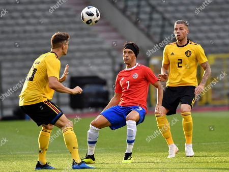Costa Rica's Christian Bolanos, center, is challenged by Belgium's Thomas Meunier, left, during a friendly soccer match between Belgium and Costa Rica at the King Baudouin stadium in Brussels
