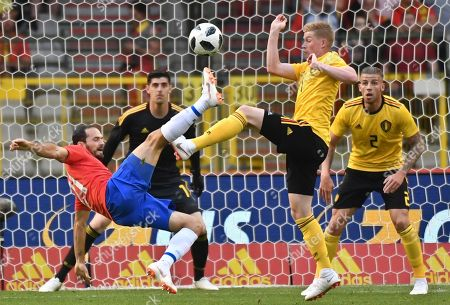 Costa Rica's Marco Urena, left, attempts a shot on goal while being blocked by Belgium's Kevin De Bruyne, second right, during a friendly soccer match between Belgium and Costa Rica at the King Baudouin stadium in Brussels