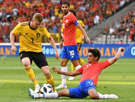 Costa Rica's Yeltsin Tejeda, right, vies for the ball with Belgium's Kevin De Bruyne, left, during a friendly soccer match between Belgium and Costa Rica at the King Baudouin stadium in Brussels