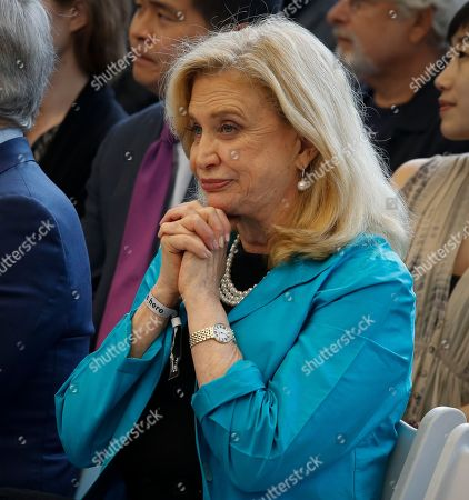 3 World Trade Opening. Democratic Rep. Carolyn Maloney listens as Silverstein Properties Chairman Larry Silverstein speaks during a ribbon-cutting ceremony, officially opening 3 World Trade Center, in New York