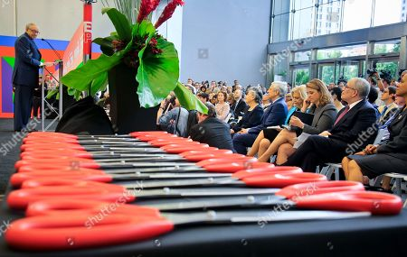 3 World Trade Opening. Sixteen pairs of scissors are laid out as Silverstein Properties Chairman Larry Silverstein, far left, addresses a gathering during the ribbon-cutting opening ceremony for 3 World Trade Center, in New York