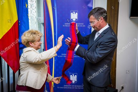 Former Dutch Prime Minister Jan Peter Balkenende (R) receives the National Order of the ?Star of Romania? in the rank of Grand Cross from the Romanian ambassador to the Netherlands Ireny Comaroschi (L) in a sign of high appreciation for the support offered to Romania in the time he served as Prime Minister of the Netherlands in the Hague, the Netherlands, 11 June 2018.