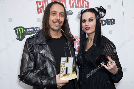 Andrea Ferro, Cristina Scabbia, Lacuna Coil. Andrea Ferro, left, and Cristina Scabbia of Lacuna Coil pose for photographers after receiving the Best Live Band award at the Metal Hammer Golden God awards, in London