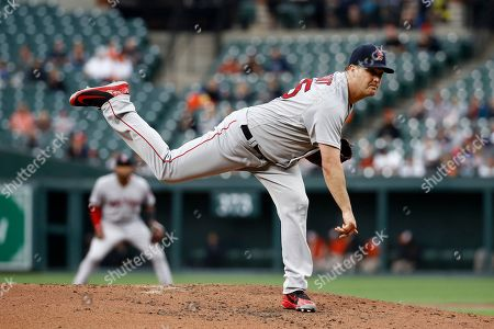 Boston Red Sox starting pitcher Steven Wright follows through on a pitch to the Baltimore Orioles in the third inning of a baseball game, in Baltimore