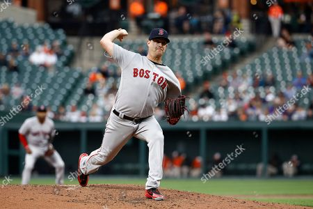 Boston Red Sox starting pitcher Steven Wright throws to the Baltimore Orioles during a baseball game, in Baltimore