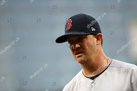 Boston Red Sox starting pitcher Steven Wright walks off the field between innings of a baseball game against the Baltimore Orioles, in Baltimore