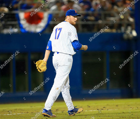 Florida pitcher Michael Byrne reacts after fielding a ground ball and throwing to first for an out during an NCAA Super Regional college baseball game against Auburn, in Gainesville, Fla