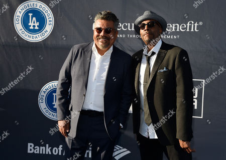 George Lopez, Arsenio Hall. Co-hosts George Lopez, left, and Arsenio Hall pose together at the Los Angeles Dodgers Foundation Blue Diamond Gala at Dodger Stadium, in Los Angeles