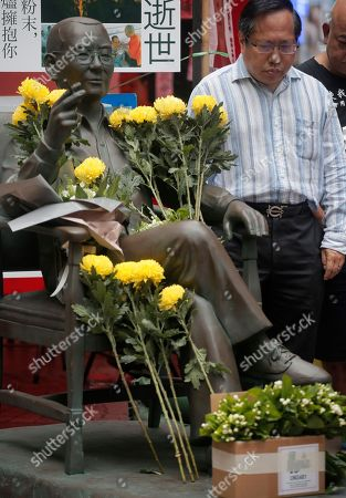 People place flowers on a statue of the late Chinese Nobel Peace laureate Liu Xiaobo during an unveiling ceremony in Hong Kong, . Activists urged the Chinese government to release iu Xiaobo's detained wife Liu Xia