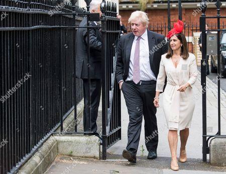 Foreign Secretary Boris Johnson leaves his London home with his wife Marina Wheeler