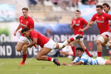 Ben Thomas of Wales is send flying as he is tackled