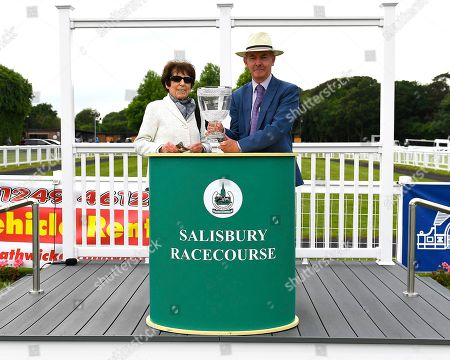 The owner of Polish, Lady Rothschild, receives her trophy for winningThe Sorvio Insurance Brokers Maiden Stakes (Plus 10) during Afternoon Racing at Salisbury Racecourse on 12th June 2018
