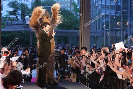 Alden Ehrenreich and Chewbacca