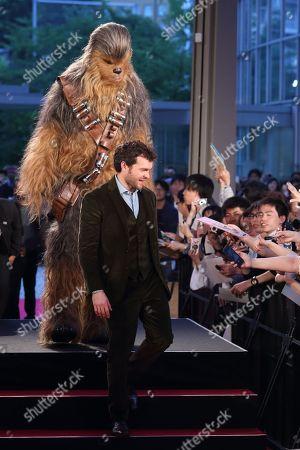 Stock Image of Alden Ehrenreich and Chewbacca