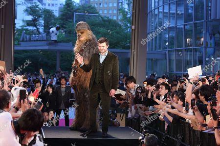 Stock Photo of Alden Ehrenreich and Chewbacca