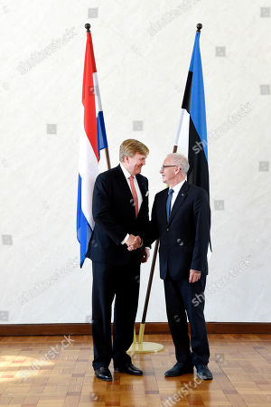 Stock Picture of Estonion Parliament Speaker Eiki Nestor receives King Willem-Alexander at Riigikogu (Parliament), Toompea in Tallinn Estonia, on day 2 of the 5-day state visit to Latvia, Estonia and Lithuania.