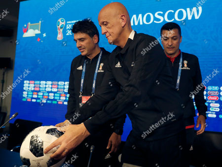 FIFA head of refereeing Massimo Busacca (L), UEFA Referees Committee Pierluigi Collina (C) and Brazilian football referee Sandro Meira Ricci  leave a referee media briefing at the Luzhniki stadium in Moscow, Russia, 12 June 2018. The FIFA World Cup 2018 will take place in Russia from 14 June to 15 July 2018.
