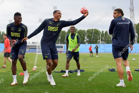 Stock Image of (L-R) Switzerland's players Breel Embolo, Manuel Akanji, Jacques Francois Moubandje and Ricardo Rodriguez during a public training session of  Switzerland's national soccer team at the Torpedo Stadium, in Togliatti, Russia, 12 June 2018. The Swiss team prepares for the FIFA World Cup 2018 taking place from 14 June until 15 July 2018.