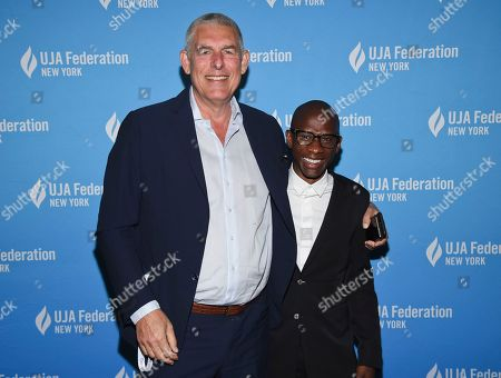 Stock Photo of Lyor Cohen, Troy Carter. Music executive Lyor Cohen, left, poses with honoree Troy Carter, Spotify's global head of creator services, at the UJA-Federation of New York's Music Visionary of the Year award luncheon at The Pierre, in New York