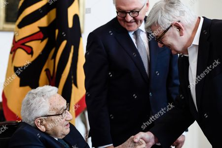 Former US Secretary of State Henry Kissinger (L) and former German Foreign Affairs Minister Joseph 'Joschka' Fischer (R) shake hands next to German President Frank-Walter Steinmeier (C) prior to a dinner in honor of former US Secretary of State Henry Kissinger at Bellevue Palace in Berlin, Germany, 12 June 2018. Henry Kissinger, who was Secretary of State in the era of US Presidents Richard Nixon and Gerald Ford, turned 95 on 27 May 2018.