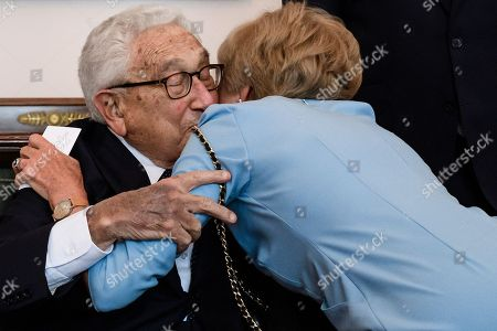 Stock Picture of Former US Secretary of State Henry Kissinger (L) and the publisher and widow of German publisher Axel Springer Friede Springer hug prior to a dinner in honor of former US Secretary of State Henry Kissinger at Bellevue Palace in Berlin, Germany, 12 June 2018. Henry Kissinger, who was Secretary of State in the era of US Presidents Richard Nixon and Gerald Ford, turned 95 on 27 May 2018.