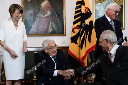 German President Frank-Walter Steinmeier (R) and his wife Elke Buedenbender (L) and former US Secretary of State Henry Kissinger (2-L) welcome the president of the German Parliament Wolfgang Schaeuble (3-L) prior to a dinner in honor of former US Secretary of State Henry Kissinger at Bellevue Palace in Berlin, Germany, 12 June 2018. Henry Kissinger, who was Secretary of State in the era of US Presidents Richard Nixon and Gerald Ford, turned 95 on 27 May 2018.