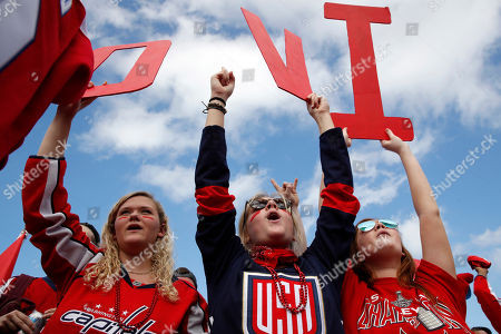 Olivia Spicer, Emma Jacobs, Caroline Schwartz. Olivia Spicer, 16, left, Emma Jacobs, 17, and Caroline Schwartz, 18, all of Gainesville, Va., hold up letters spelling the nickname of Washington Capitals' left wing Alex Ovechkin, from Russia, on the National Mall ahead of a victory parade and rally for the Washington Capitals as hockey fans celebrate their winning the Stanley Cup, in Washington