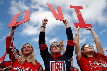 Stock Picture of Olivia Spicer, Emma Jacobs, Caroline Schwartz. Olivia Spicer, 16, left, Emma Jacobs, 17, and Caroline Schwartz, 18, all of Gainesville, Va., hold up letters spelling the nickname of Washington Capitals' left wing Alex Ovechkin, from Russia, on the National Mall ahead of a victory parade and rally for the Washington Capitals as hockey fans celebrate their winning the Stanley Cup, in Washington