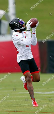 Atlanta Falcons wide receiver Justin Hardy (14) catches a pass during an NFL minicamp football practice in Flowery Branch, Ga