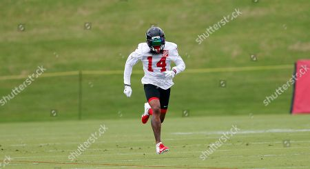 Atlanta Falcons wide receiver Justin Hardy (14) runs a pass route during an NFL minicamp football practice in Flowery Branch, Ga