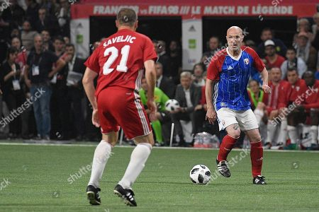 French former soccer player Frank Leboeuf (R) in action during a friendly soccer match between a selection of French 1998 World Champion soccer players (France98) against an international selection (FIFA98) at the U Arena in Paris, France, 12 June 2018.