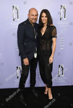 John Varvatos, Joyce Zybelberg Varvatos. Designer John Varvatos, left, and wife Joyce Zybelberg Varvatos attend the Fragrance Foundation Awards at Alice Tully Hall, in New York