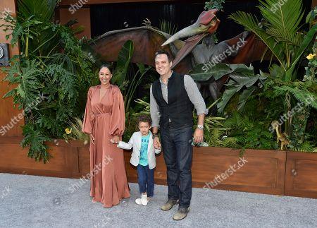 "Tamera Mowry-Housley, Adam Housley, Aden. Tamera Mowry-Housley, left, Adam Housley, right, and their son Aden arrive at the Los Angeles premiere of ""Jurassic World: Fallen Kingdom"" at the Walt Disney Concert Hall on"