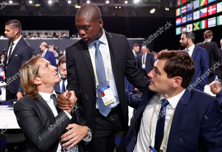 Clarence Seedorf of the Netherlands talks to Spain's Miguel Salgado, left and Iker Casillas at the FIFA congress on the eve of the opener of the 2018 soccer World Cup in Moscow, Russia, . The congress in Moscow is set to choose the host or hosts for the 2026 World Cup